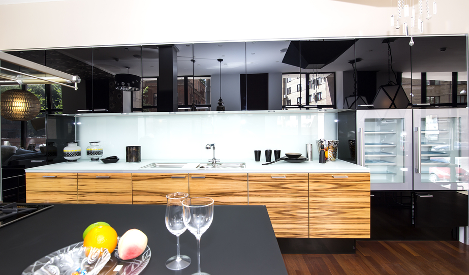Luxury high end black and wood kitchen with top-of-the-line appliances