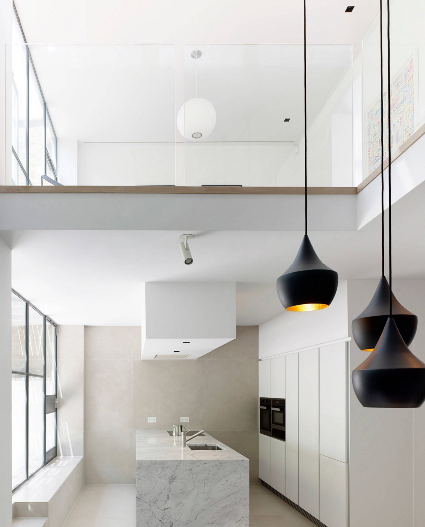 Tom Dixon lighting in a modern kitchen and dining area