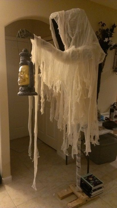 Cloaked-Halloween-ghost-decorations-with-skull-lantern