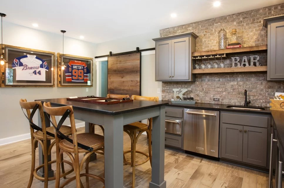 Industrial kitchen with wall mounted wine glass rack