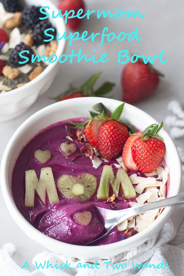 Supermom (with pink power) Superfood Smoothie Bowl is a pretty pitaya superfood packed smoothie bowl to give mom the energy needs to be SuperMom! Customizable plant-based (vegan and gluten free) smoothie with super food boosts!