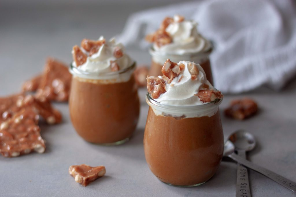 Pumpkin Pie Peanut Brittle Pudding Cups, pumpkin pie pudding Cups with whipped cream and peanut brittle