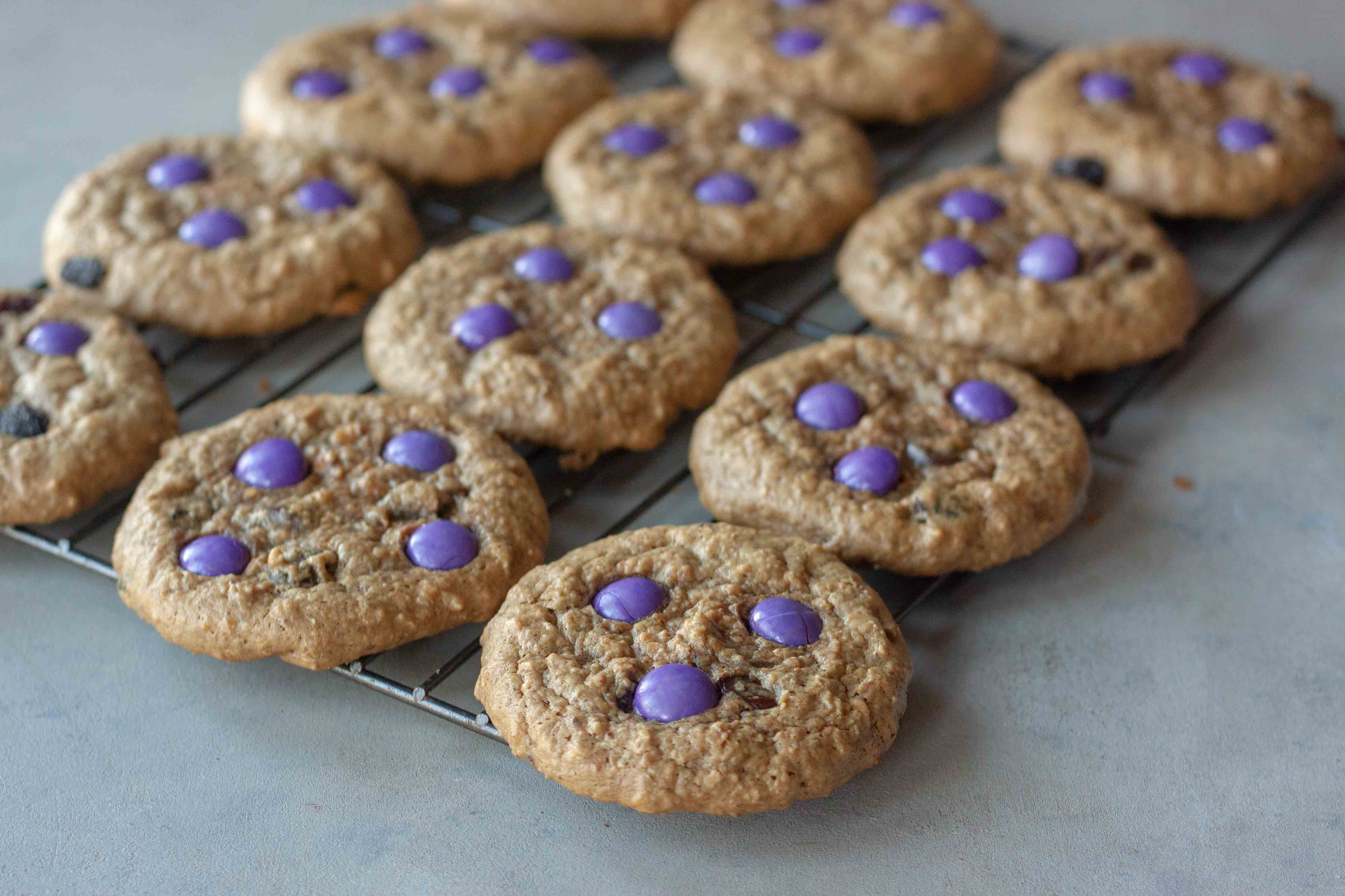 Cooling rack with Milk Monster Cookies.