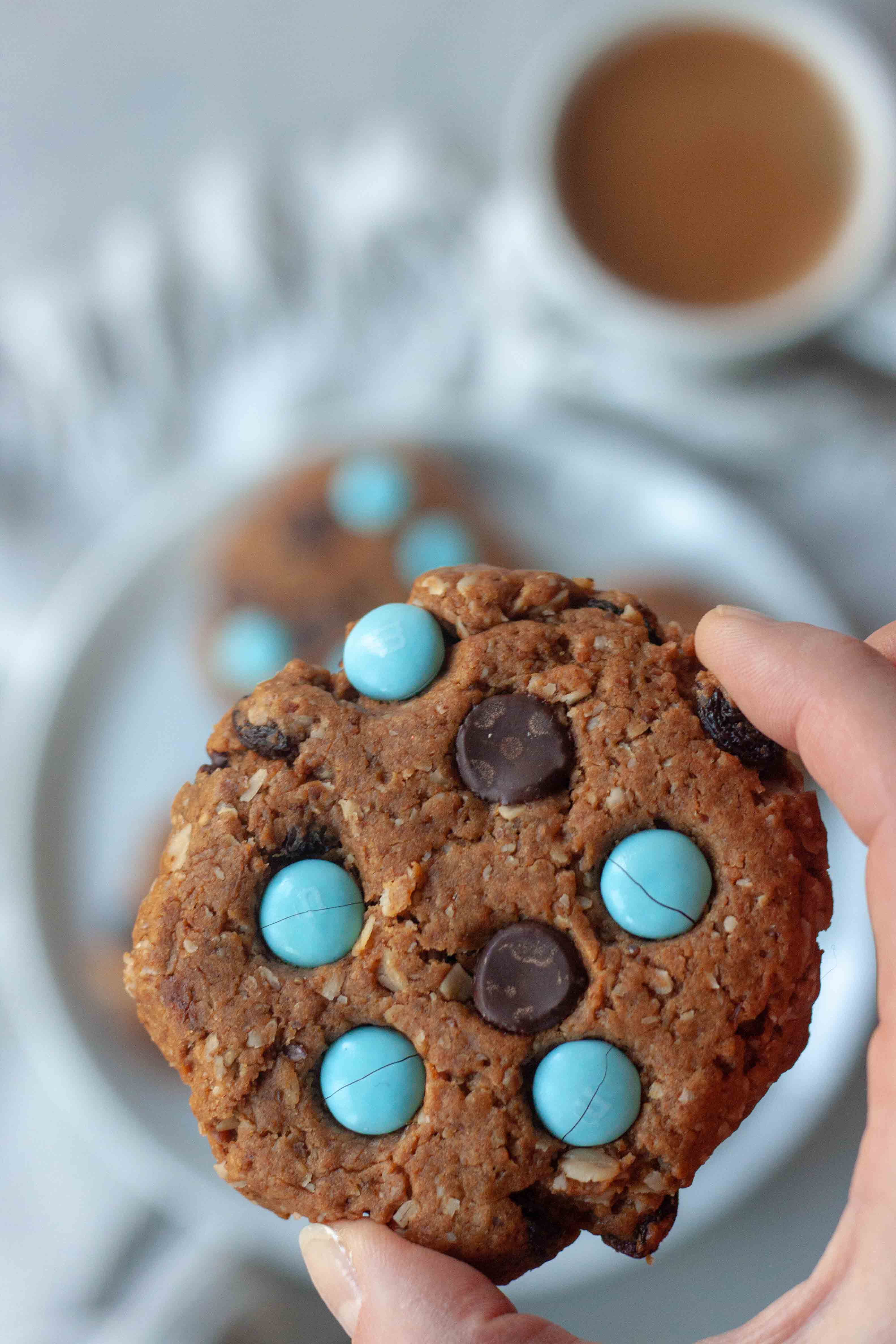 Holding a Milk Monster Cookie.