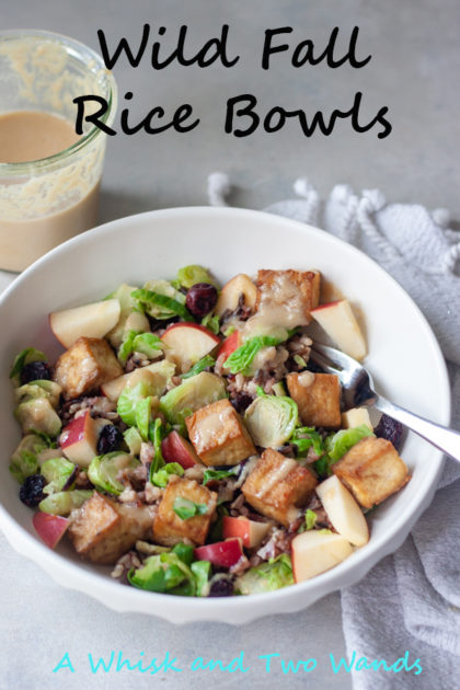 Delicious Wild Fall Rice Bowls are filled with wild rice blend, crispy tofu, sweet crisp apples (we like Honeycrisp), shaved brussels sprouts, dried cranberries, and top with Maple Tahini Dressing. Packed with flavor and nutrition they're gluten free and vegan friendly and perfect for meal prep.