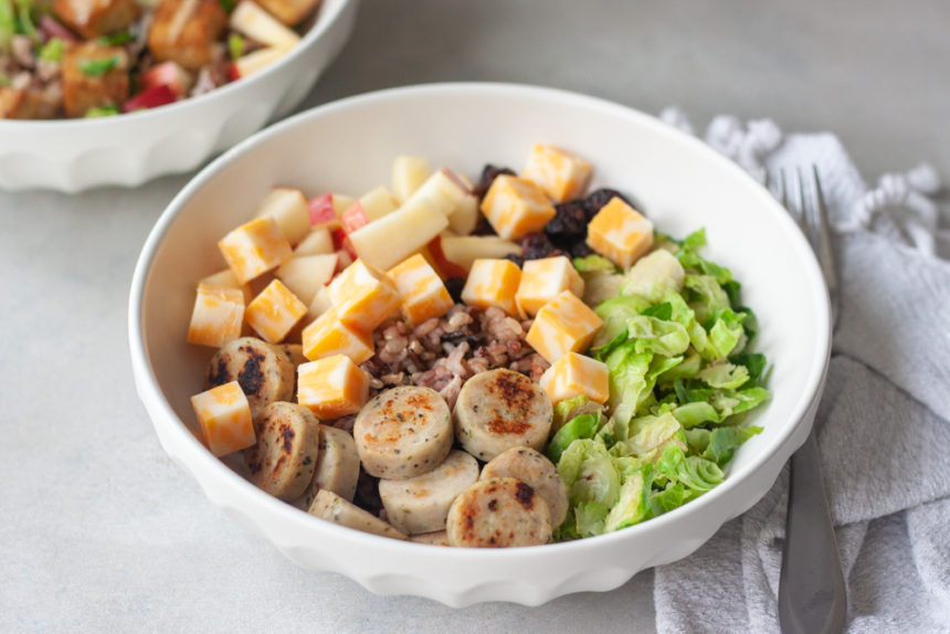 Wild Child Bowl is a blend of wild rice, chicken sausage, apples, brussels, cheese, and dried cranberries