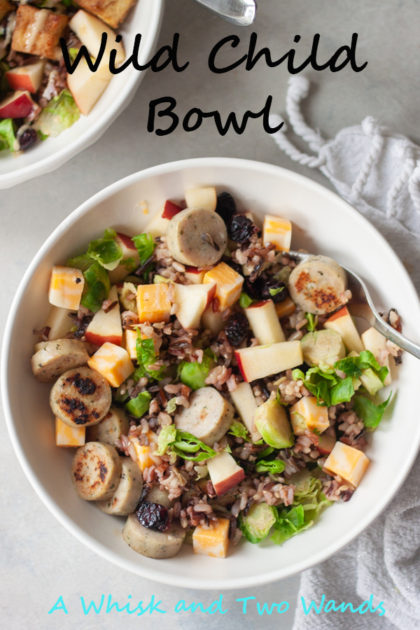 Delicious and filling Wild Child Bowl is a blend of wild rice, chicken sausage, apples, brussels, cheese, and cranberries that is great for lunch or dinner and perfect for meal prep or a quick weeknight meal. Gluten free and customizable to be vegetarian, dairy free, or even vegan.