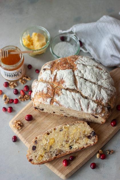 Cranberry Walnut Spelt Sourdough Bread slice with honey