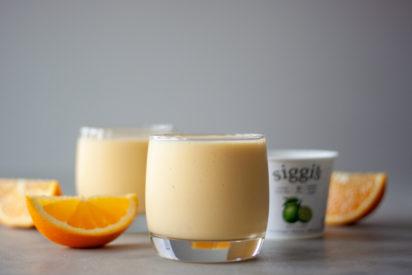 Mango Orange Key Lime Smoothies, orange wedges, yogurt container