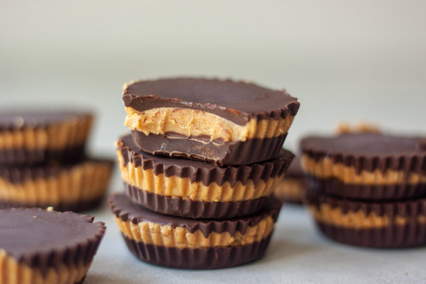 Stacked Protein Peanut Butter Cups with bite