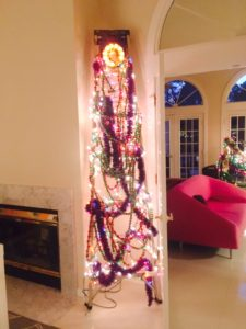 """""""Hiding"""" a ladder in plain sight. Garland, lights, and a tree topper."""