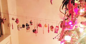 Tree falling over? Wire it to the wall and hang ornaments from the wire!