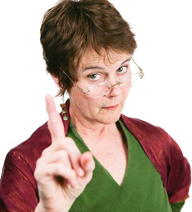 Middle-aged woman shaking a scolding finger in disapproval