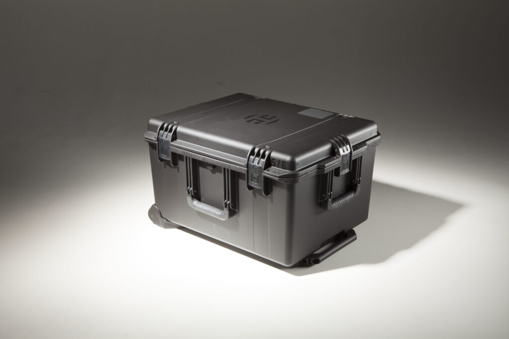 A custom black heavy-duty plastic cargo case with the Harden H logo on the lid.
