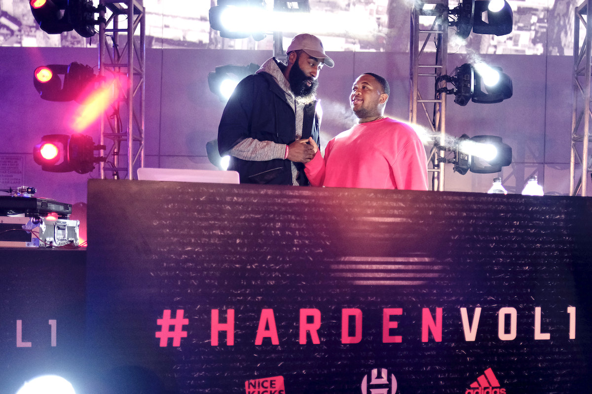 James Harden and a DJ on stage.
