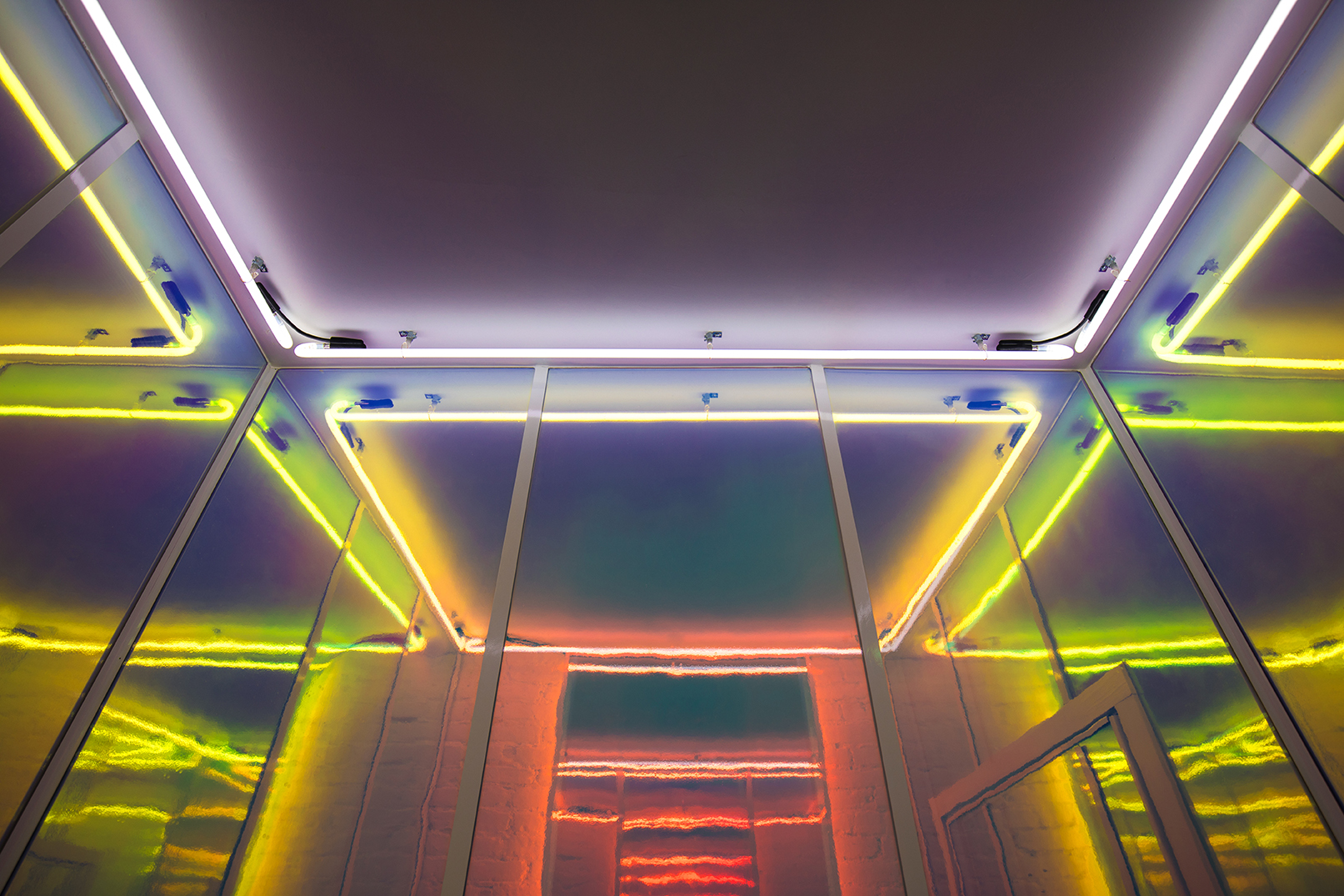 The neon lit ceiling of the fitting room.