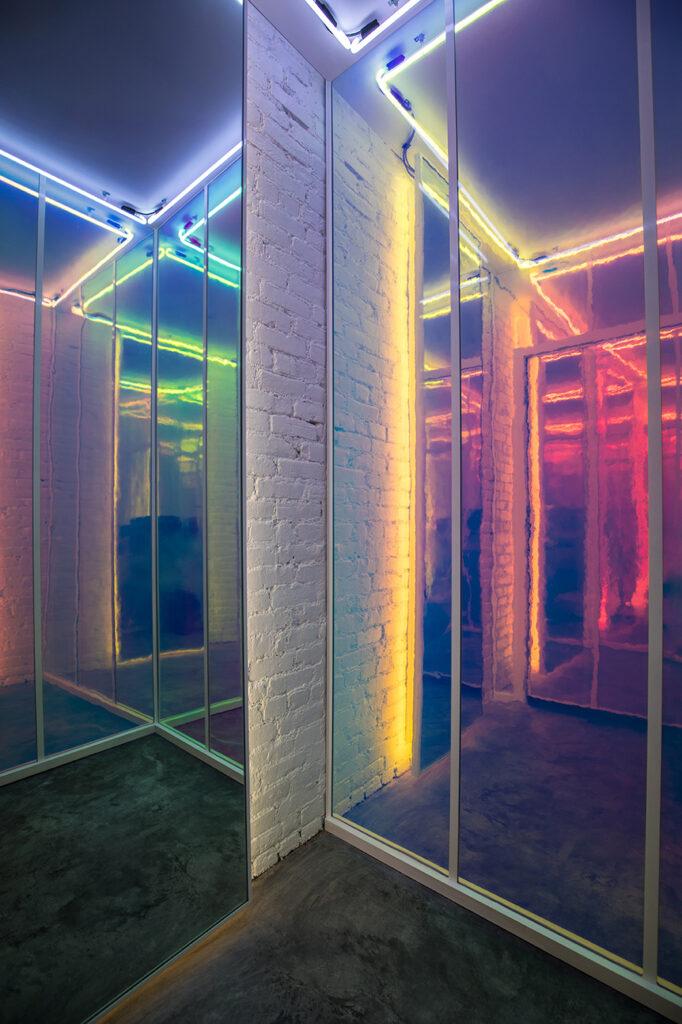 The iridescent, rainbow lit mirrored changing room.