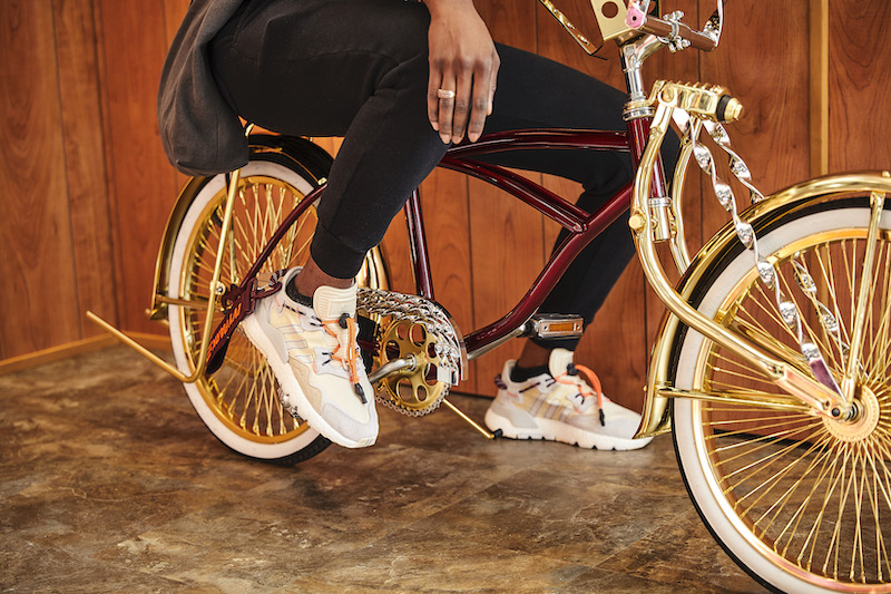 Close-up of the shoes of someone posing on the lowrider.