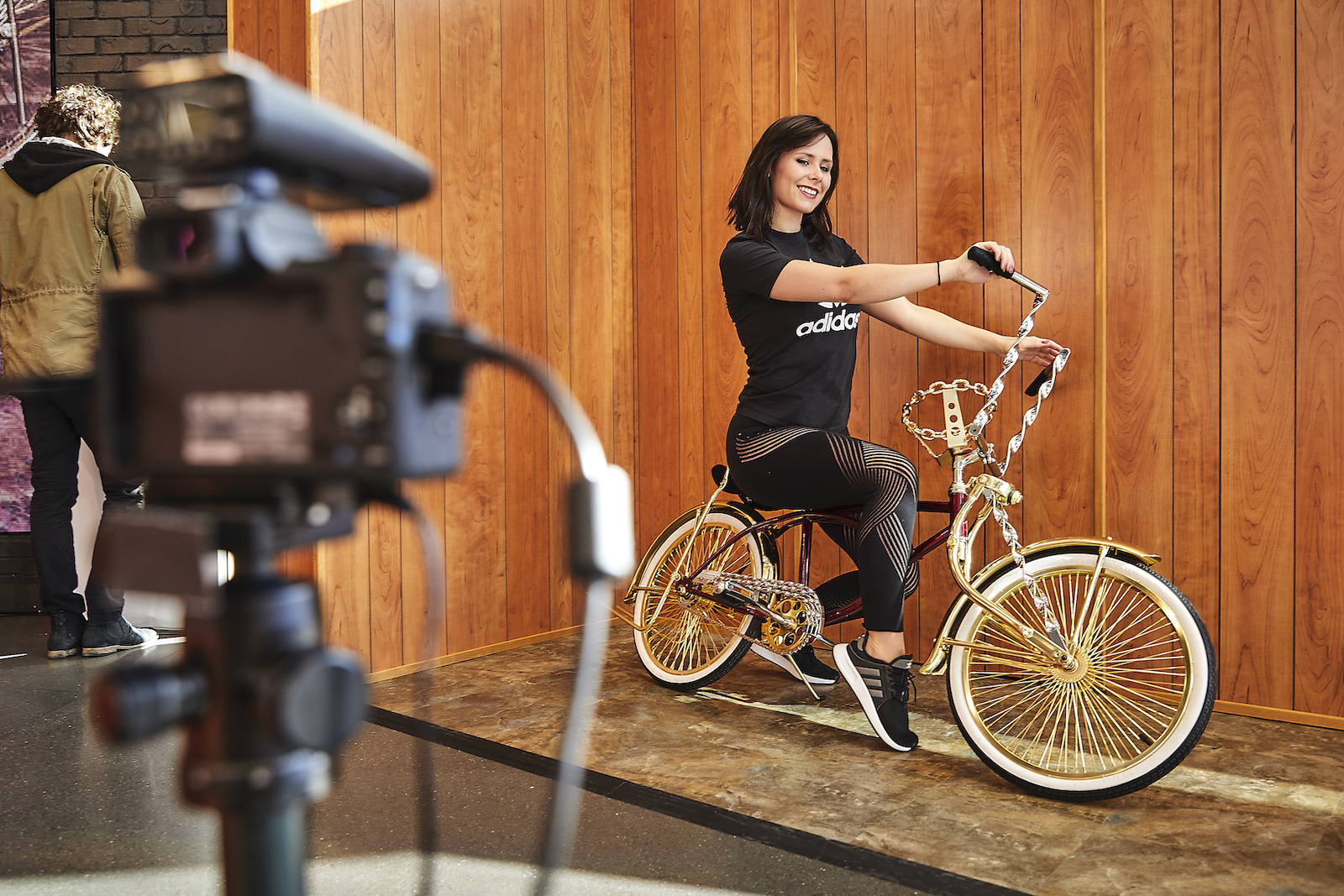 Woman poses on the lowrider for a photo op.