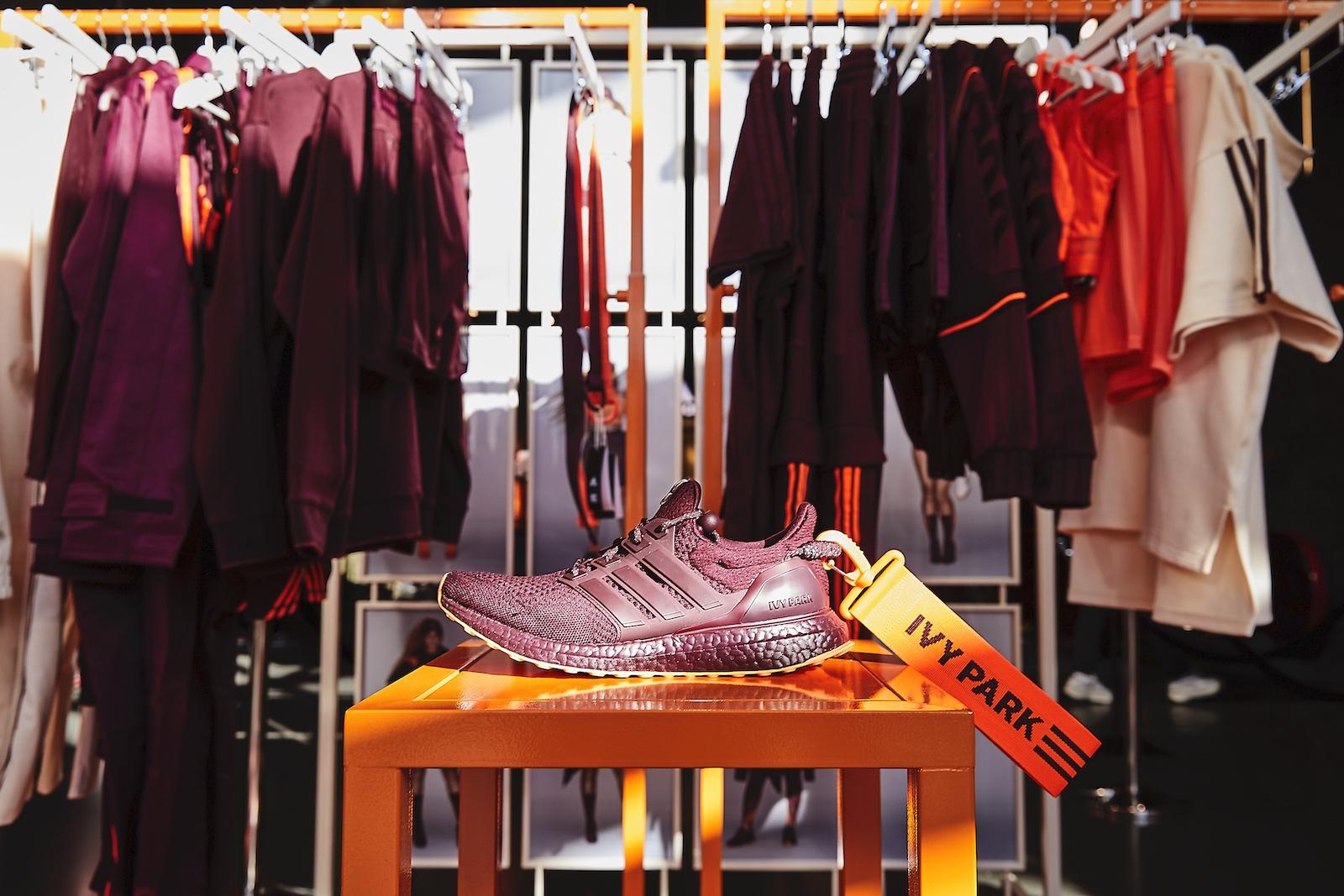 Burgundy Ivy Park sneaker propped on an orange pedestal.