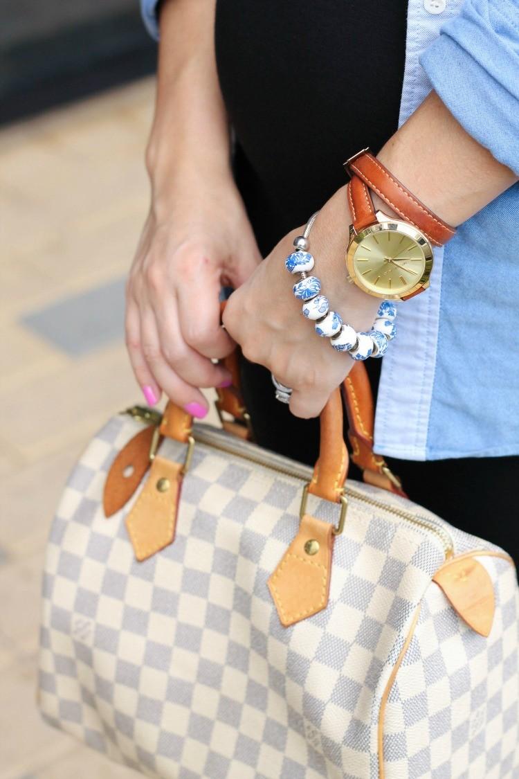 Michael Kors wrap watch, and Louis Vuitton bag