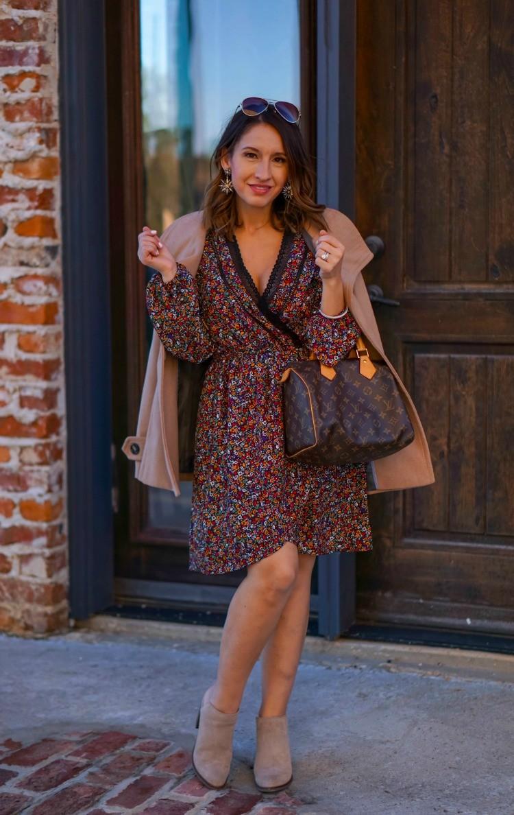 Camel coat, floral dress, nude booties, and Louis Vuitton handbag
