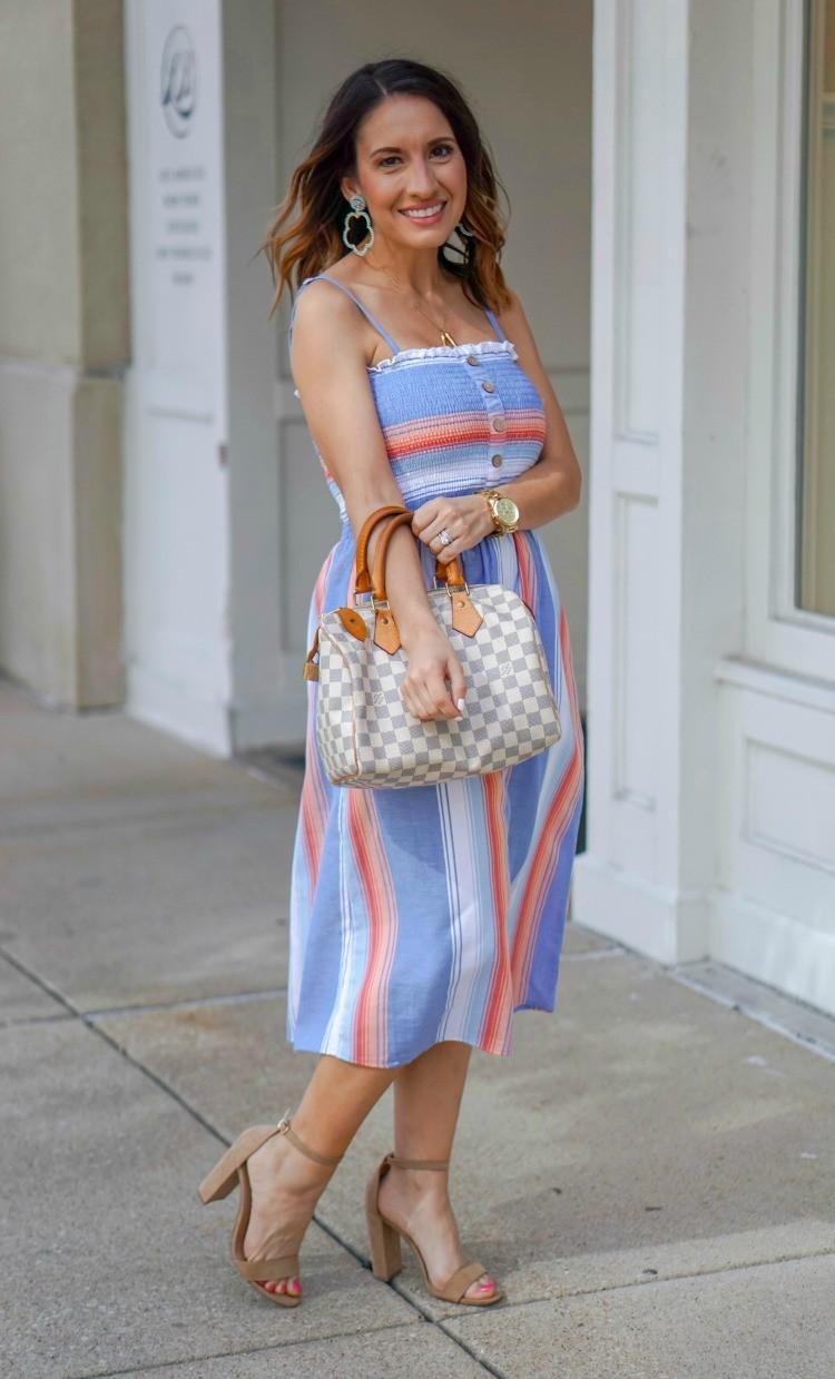 Lisi Lerch Earring, Smocked Bodice Stripe Midi Dress, and Louis Vuitton Handbag