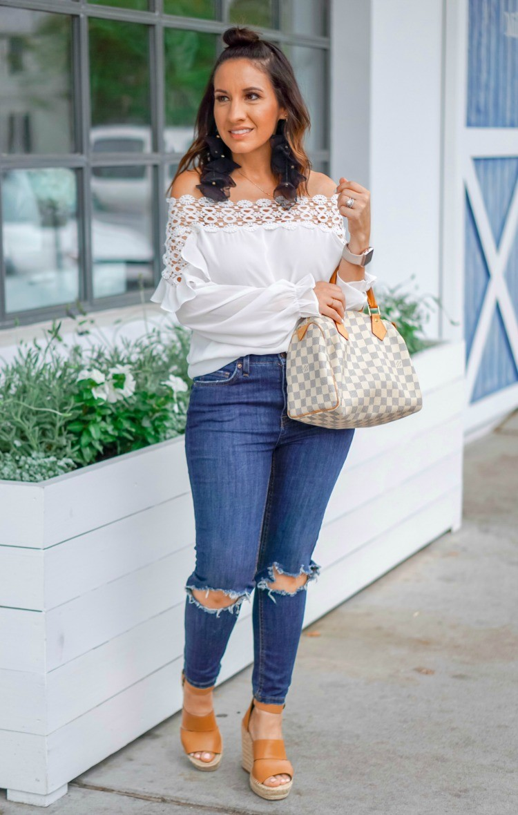 Off the shoulder top, skinny jeans, and wedges