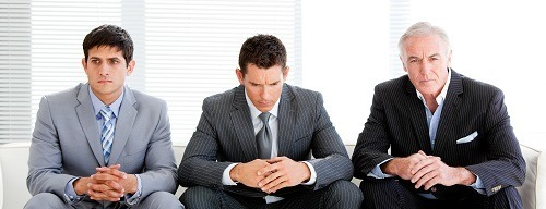 businessmen waiting for executive job interview