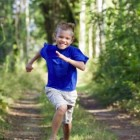 Boys Running in the Woods