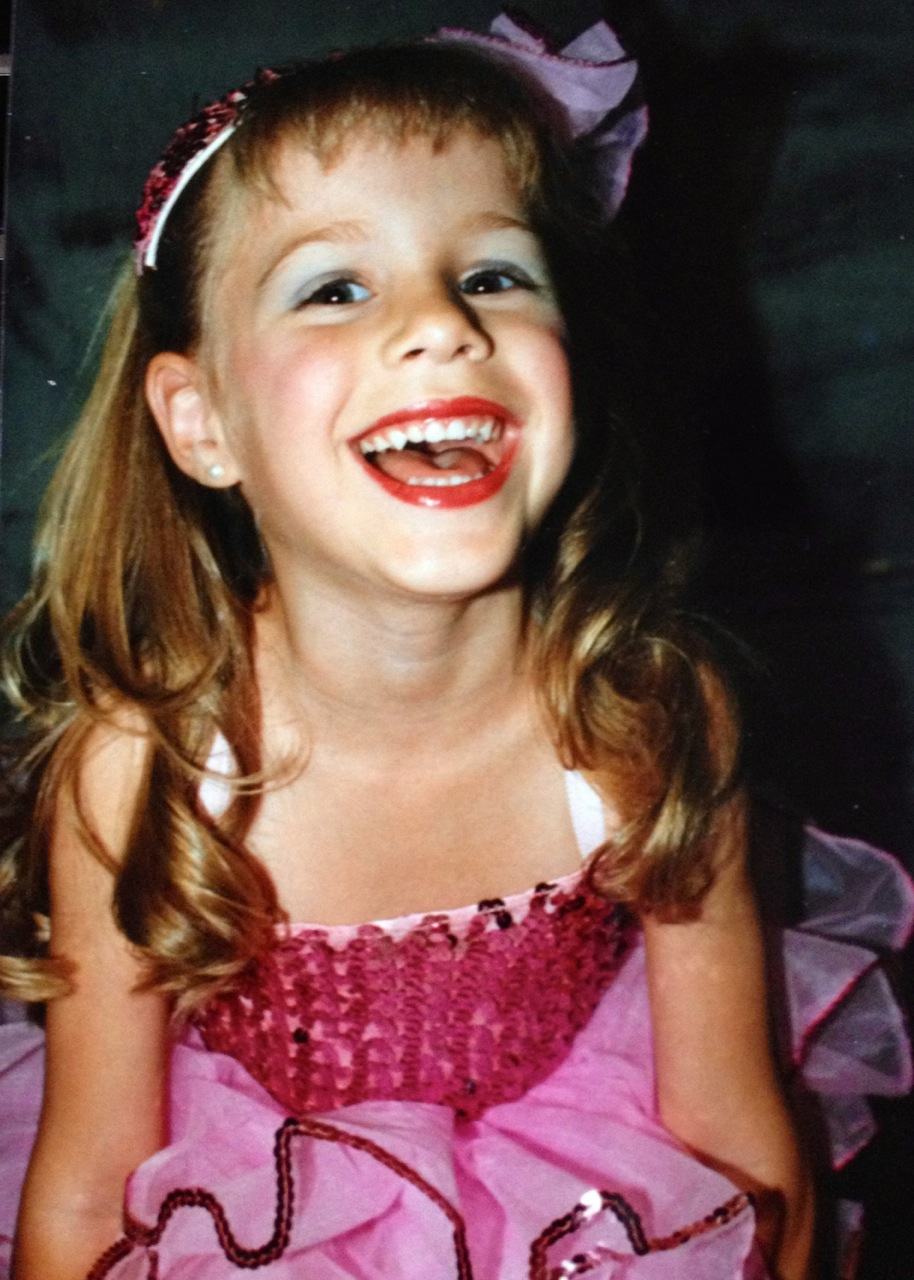 Courtney age 4 before her ballet recital.  She loved being all dressed up.