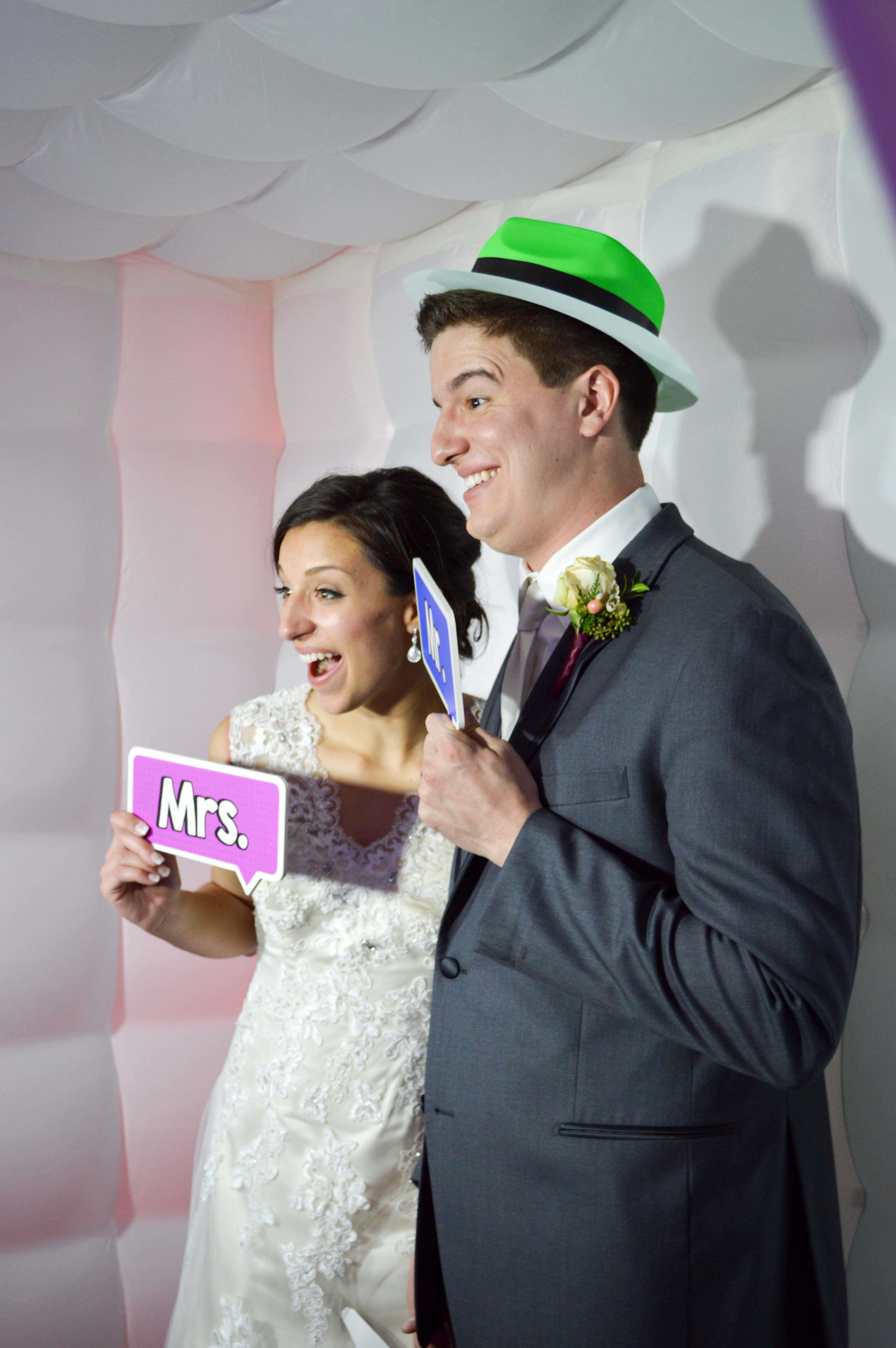 Bride and Groom Capture the moment in the Photo Booth