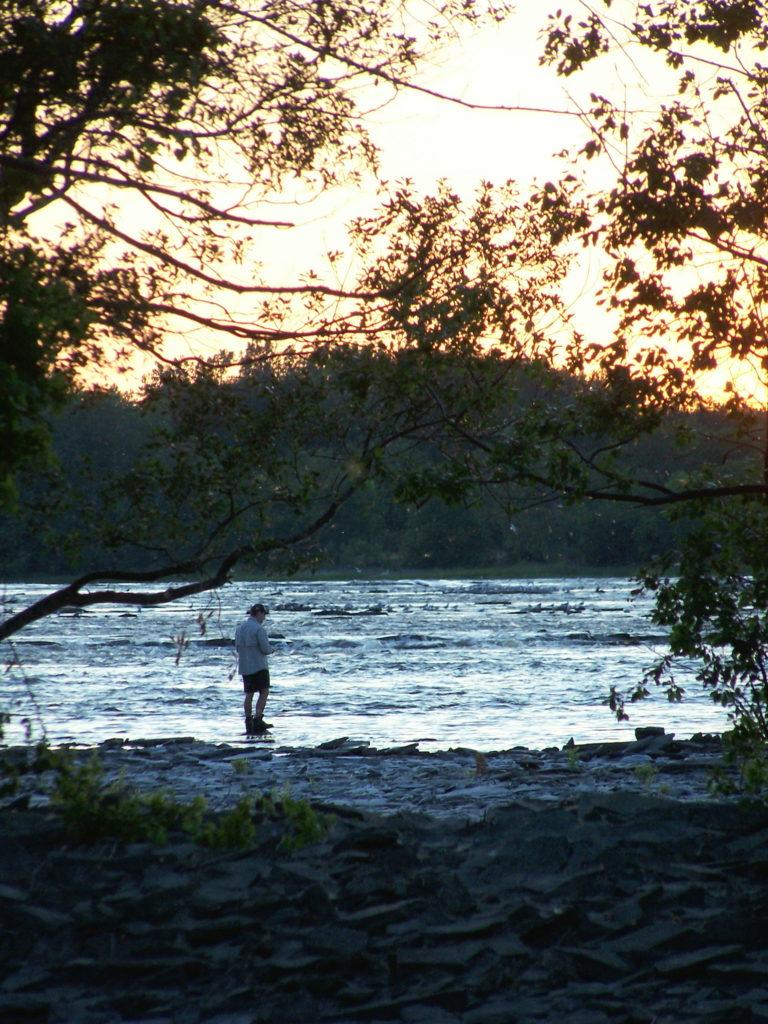 A fishermen casts into the Ottawa River near Mud Lake at sunset.