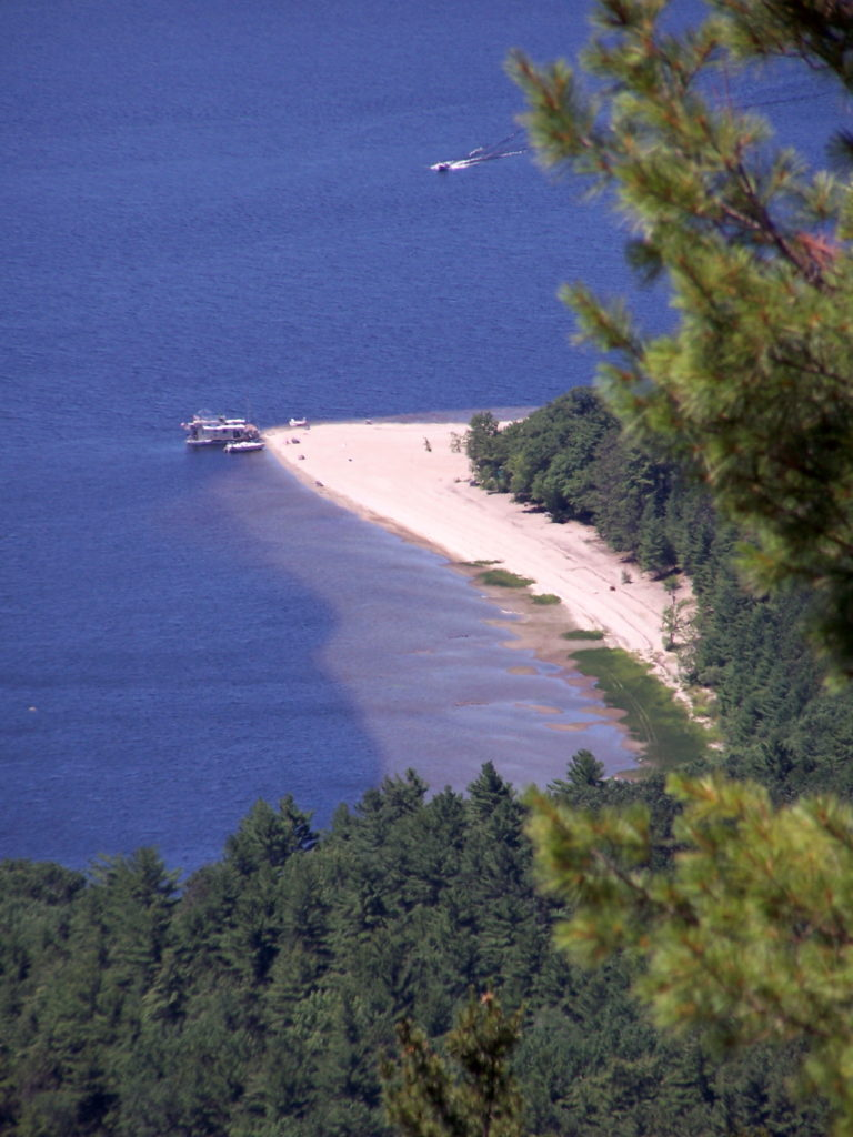 From far above on Mount Martin, the sandy beach and shoals of Houseboat Point can be seen reaching out into the blue Ottawa River