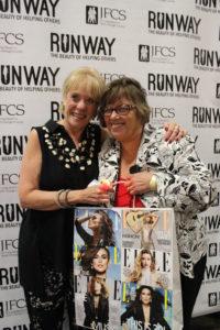 The previous year's New York Experience winner Nancy Linden congratulates Ann Martin, last year's lucky winner.