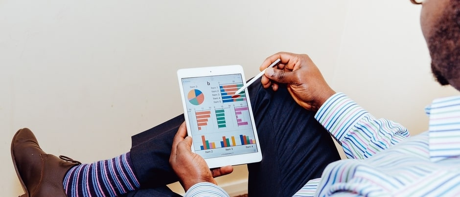 Man creating financial plan on tablet