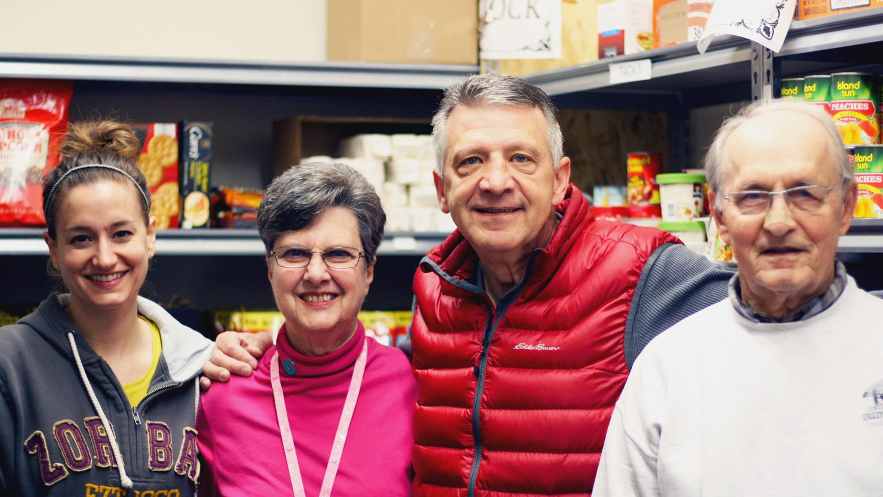 Four food shelf volunteers