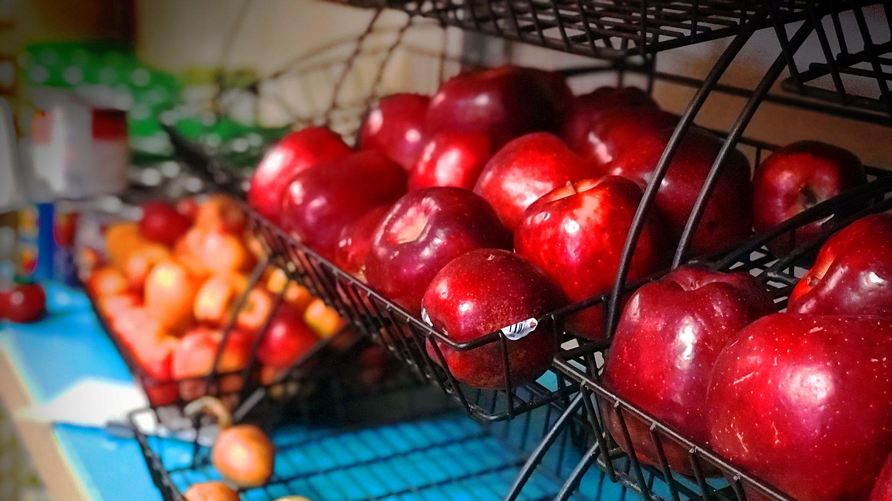A basket of apples in a food shelf