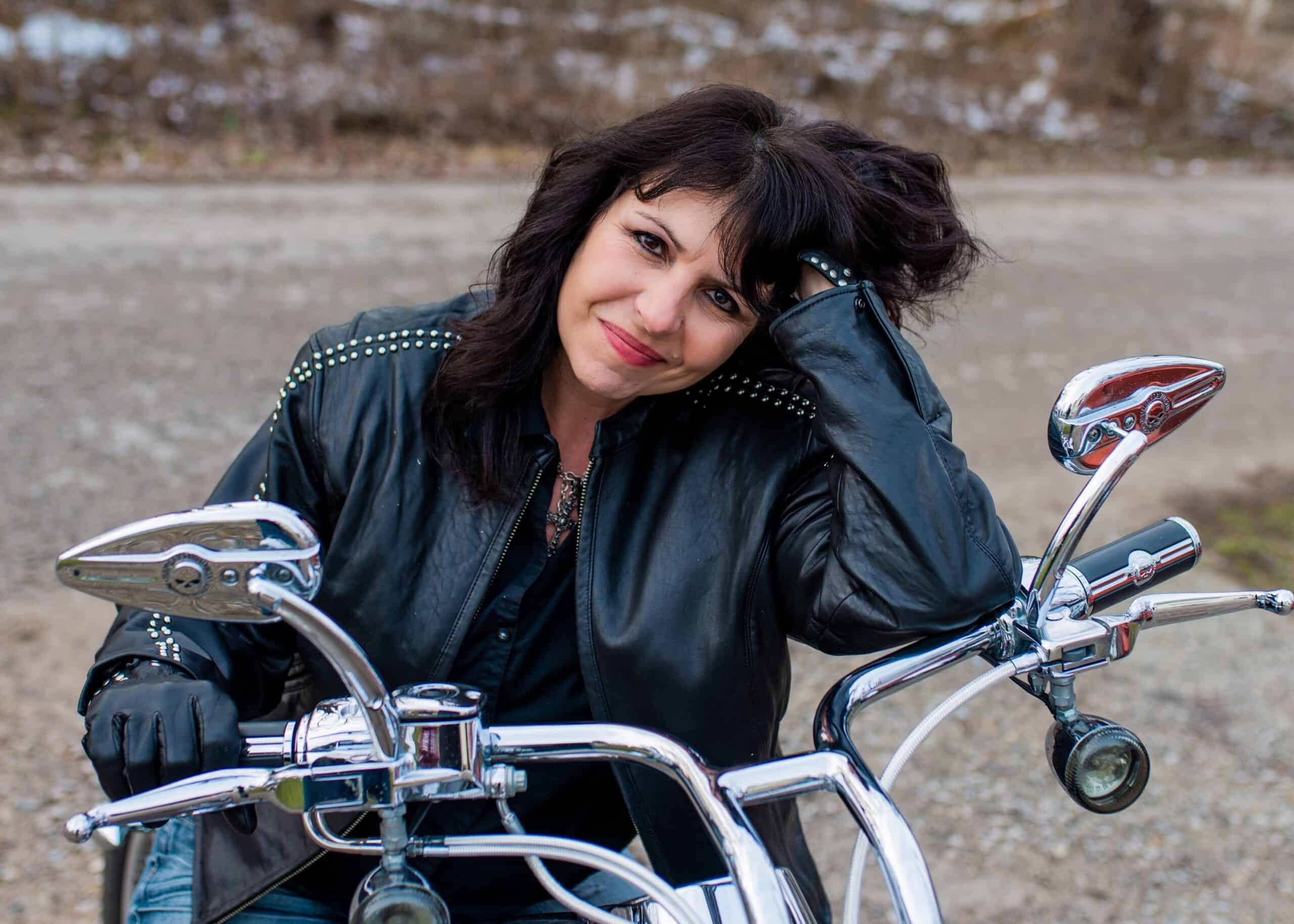 Close up of woman sitting on a motorcycle