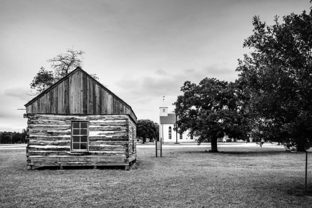 A black and white photo of the setting of old Wendish church in Texas
