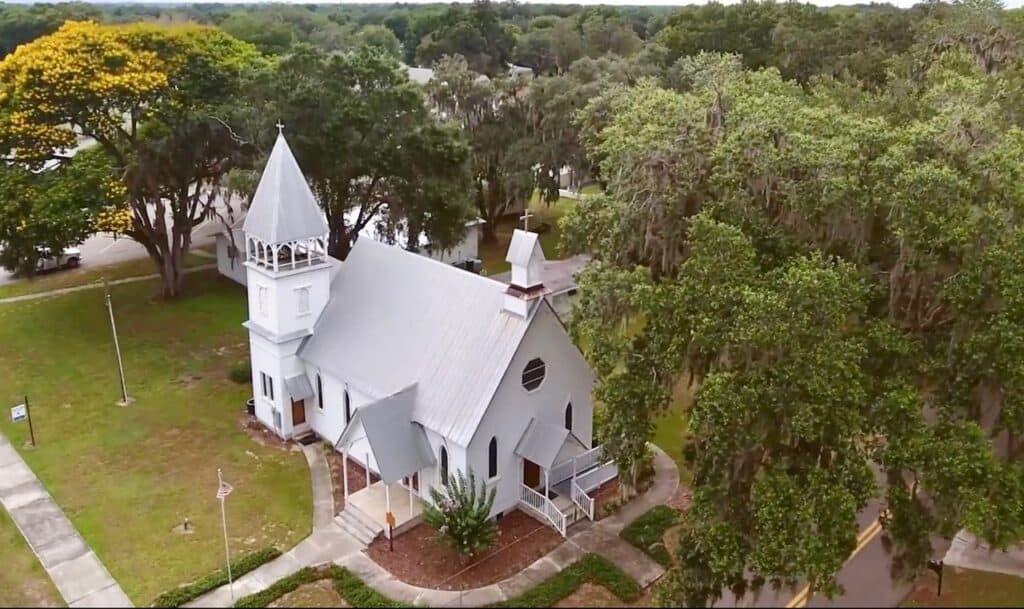 aerial view of a little white church