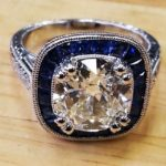 Front side- invisible channel set hand cut sapphire and diamond engagement ring