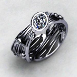 Dragonfly wings ring in palladium and real Pure Grown synthetic diamonds.