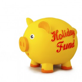 """Yellow piggy bank, marked, """"Holiday Fund"""""""
