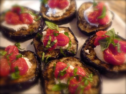 Cooking from our food families, Donna made Grilled Eggplant Rounds with ricotta cheese, basil and Dorie's Slow-Roasted Tomatoes.