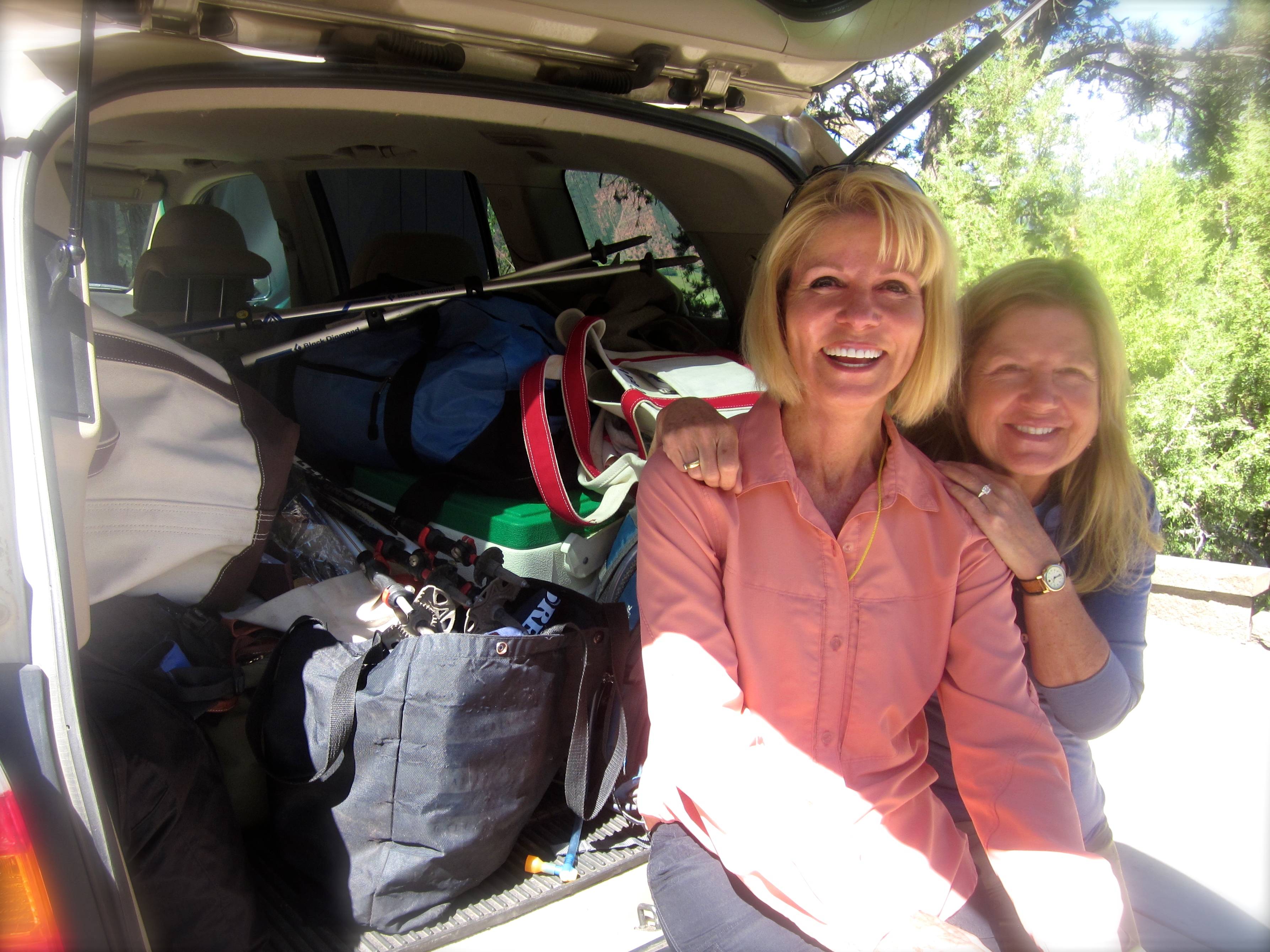 DonnaC and Francine are unable to explain why an overnight trip with four women requires all this luggage.(So, they smiled instead.)