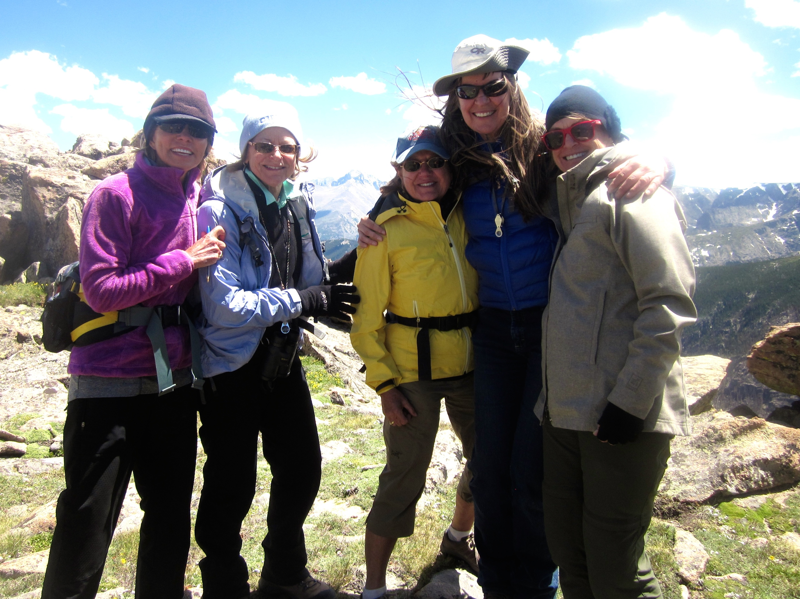 This is the highest we climbed. Think Base Camp at Mt. Everest. Long's Peak, 14,259' (4,346M) is in the background. We're with our instructor who thinks this is fun!