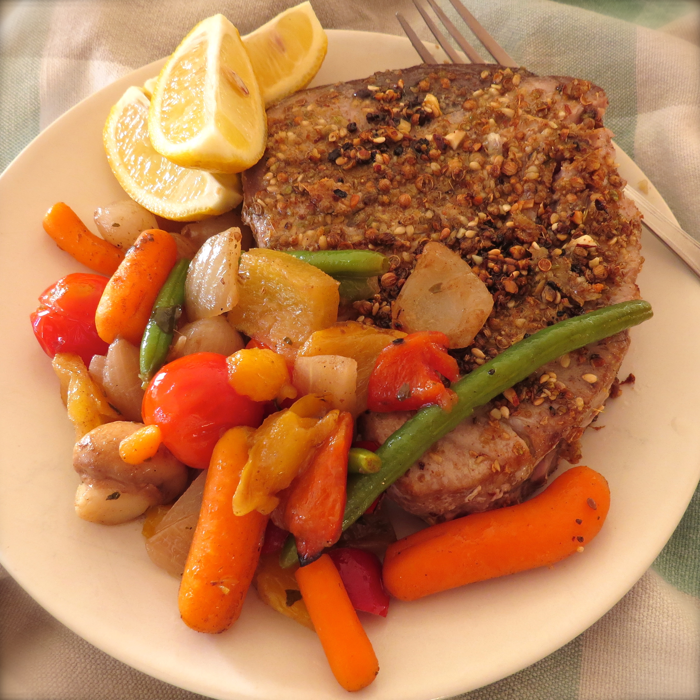 Spice-crusted Tuna with lemon wedges and Roasted Vegetables