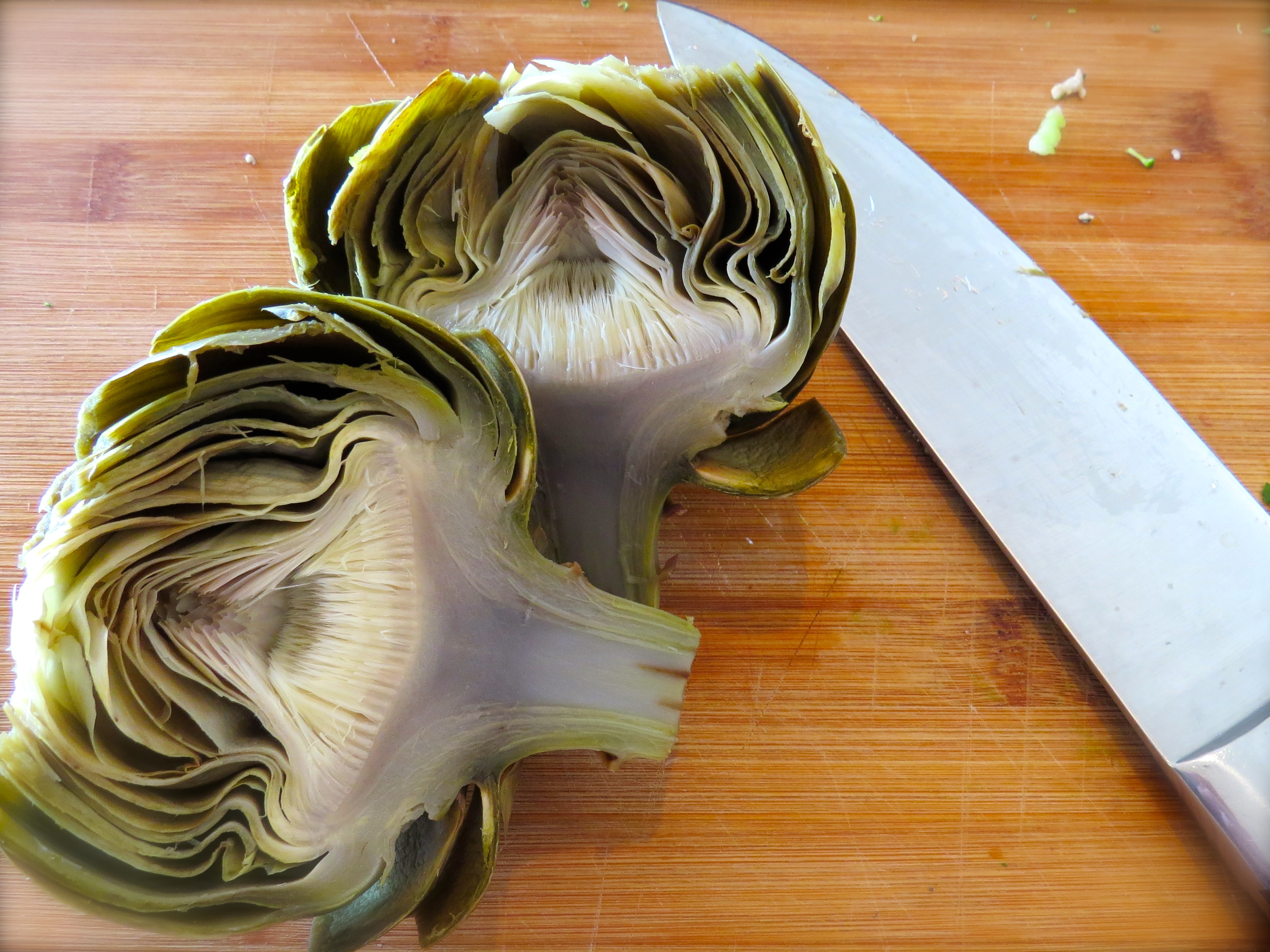 After I sliced the steamed artichoke in two, I needed to scrape out the choke (the fuzzy center.)
