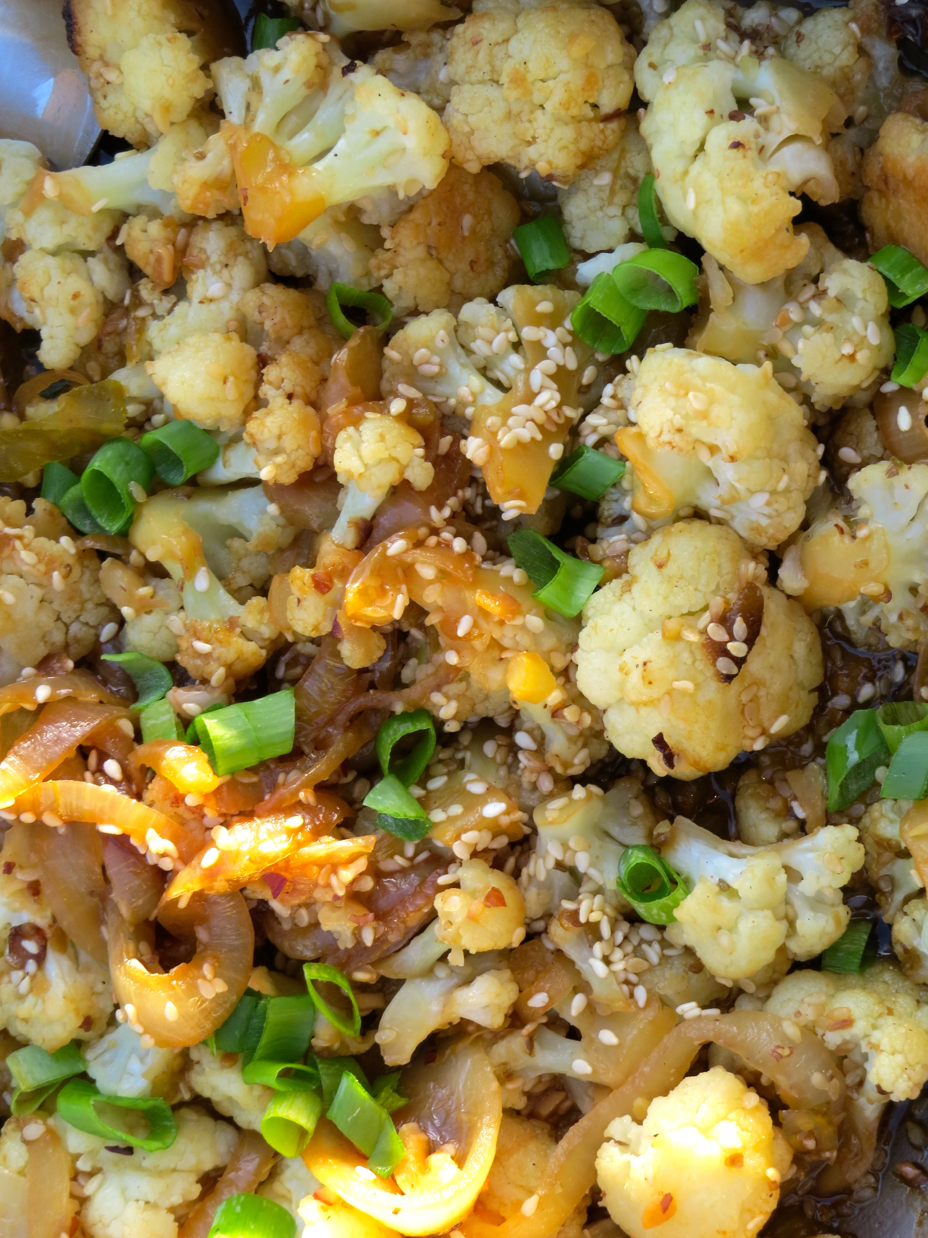 Stir-fried Sesame Cauliflower, a strongly seasoned side dish with chile, garlic and ginger.